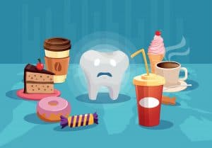 Tooth surrounded with sugar unhealthy food